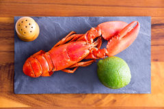 Cooked Red Lobster on a Board with Lime and Salt royalty free stock image