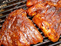 Cooked ribs. Barbeque ribs on grill the royalty free stock images