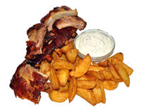 Cooked Ribs And Potato Wedges Stock Photography