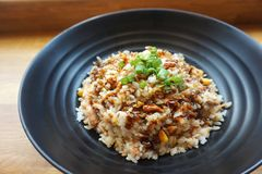 Cooked Rice on Black Ceramic Plate Royalty Free Stock Photo