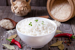 Cooked rice into a bowl on a table. Cooked rice into a bowl on a wooden table Royalty Free Stock Photo