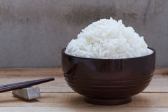 Cooked rice in bowl on wood background stock photos