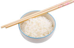 Cooked rice. Chopsticks on bowl with cooked rice Stock Photography
