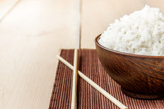 Cooked rice and chopsticks Stock Images