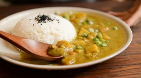 Cooked Rice and Curry Food Served on White Plate Stock Images