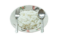 Cooked rice. On dish with spoon and fork isolated on white background Stock Image