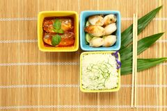 Cooked rice with fish in sauces and cuttlefish Stock Image