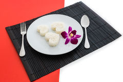 Cooked rice heart shapes with a spoon and fork on white dish and Royalty Free Stock Image