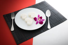 Cooked rice heart shapes with a spoon and fork on white dish and Royalty Free Stock Photos