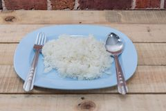 Boiled rice with spoon and fork Royalty Free Stock Photo
