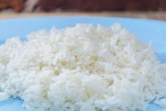 Boiled rice with spoon and fork Stock Image