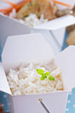 Cooked rice in a take away box Stock Photography