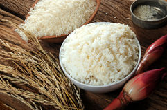 Cooked rice, uncooked rice and paddy rice on wooden tabel Royalty Free Stock Image