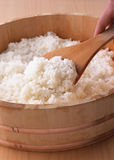 Cooked Rice in Wooden Bowl with Spoon Royalty Free Stock Image