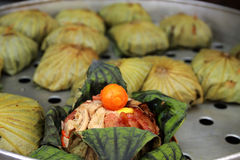 Cooked rice wrapped with lotus leaf Stock Image