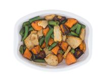 Cooked roasted turkey TV dinner. Top view of a cooked roasted turkey, sweet potato and green bean TV dinner meal in a microwavable tray isolated on a white royalty free stock photo