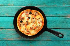 Cooked round mushroom pizza in skillet Royalty Free Stock Photos