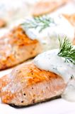Cooked salmon. Fillets with dill sauce on white plate Stock Photography