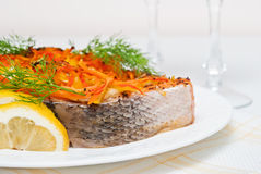 Cooked salmon covered with carrots and dill with lemon pieces  Stock Images