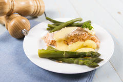 Cooked salmon. A cooked salmon fillet served with asparagus new potatoes and green beans Stock Photo
