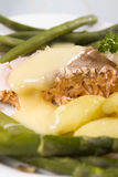 Cooked salmon. A cooked salmon fillet served with asparagus new potatoes and green beans Royalty Free Stock Images