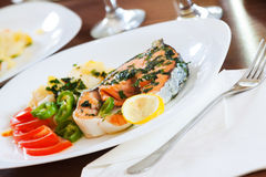 Cooked salmon fish. On the dish Stock Photos