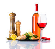 Cooked Salmon Fish Fillet with Wine. Bottle and Glass Rose Wine with cooked Salmon Fish Fillet and spices isolated on white background Stock Images