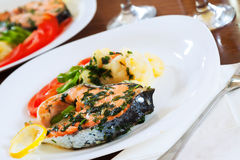 Cooked salmon fish. On the plate Stock Photography