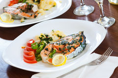 Cooked salmon fish in plate Royalty Free Stock Photography