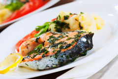 Cooked salmon fish on the plate. At table Stock Photography