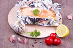 Cooked salmon in a foil royalty free stock photography