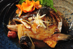 Cooked salmon head with plum Royalty Free Stock Image