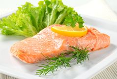 Cooked salmon. Juicy cooked salmon with lemon Stock Images
