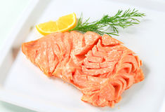 Cooked salmon. Juicy cooked salmon with lemon Stock Photos