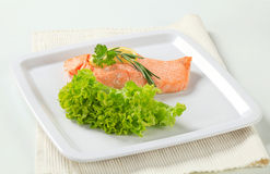 Cooked salmon. Juicy cooked salmon with lemon Royalty Free Stock Photography