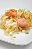 Cooked salmon with organic pasta. Some fresh cooked salmon with organic pasta Royalty Free Stock Images