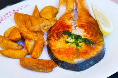 Cooked salmon  with potatoes. Cooked salmon fish with potatoes Stock Photo