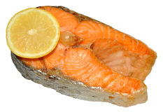 Cooked Salmon Steak. One cooked pink salmon steak with lemon slice, isolated on a white background Stock Images