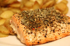 Cooked Salmon Steak with potatoes Stock Photo