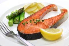 Cooked salmon steak. On white dish Royalty Free Stock Image