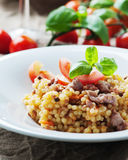 Cooked sardinain pasta fregola with tomato and sausage Stock Images