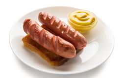Cooked sausage with mustard Royalty Free Stock Photos