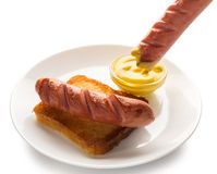Cooked sausage with mustard Royalty Free Stock Photo