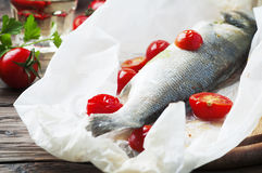 Cooked seabass with tomato and parsley Stock Photography