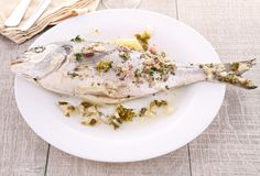 Cooked seabream. Plate with gourmet cooked seabream Stock Photos