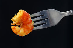 Cooked shrimp on a fork Stock Image