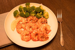 Cooked shrimp with lemon and broccoli Stock Photo