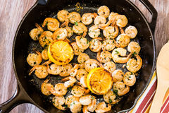 Free Cooked Shrimp Meal With Lemon In Cast Iron Skillet Royalty Free Stock Image - 89836556