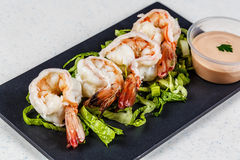 Cooked shrimps on black slate stock images