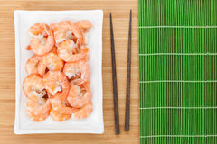 Cooked shrimps and chopsticks Royalty Free Stock Image